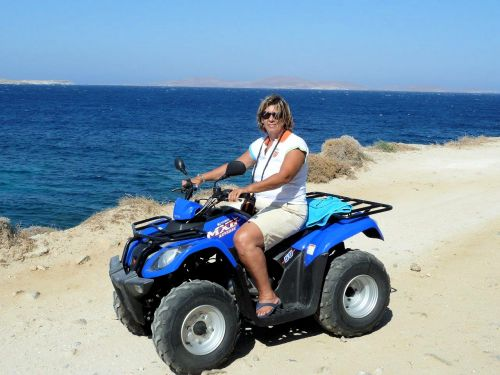 Deniz Bensason, Photographer - On ATV on Santorini