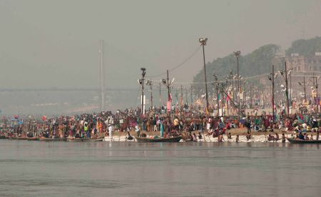 Pages 8-9 Kumbh Mela Festivities in the Ganges River in Allahabad