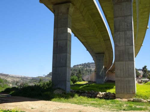 Jerusalem Trail: A question of semantics: Is the bridge soaring or hulking over the path? - © Deniz Bensason
