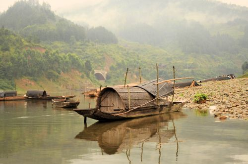 Zhaoxing: Boats on misty river