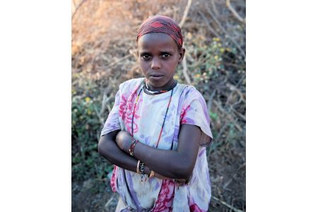 Children of the World: Ethiopia; girl trying to communicate