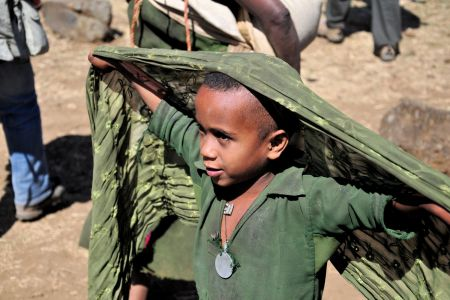 Children of the World: Ethiopia; boy in the market playing