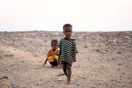 Children of the World: Ethiopia; two small kids in the middle of the desert