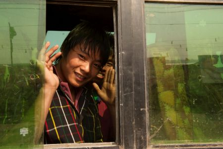 Children of the World: India; Waving from the bus window