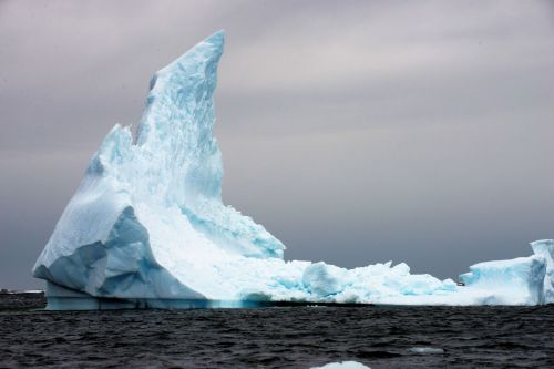 Landscapes/Icebergs and Pack ice - Lemaire Channel-Petermann Bay: A sailing tower of a -berg