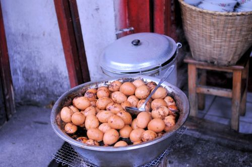 Markets-Products - Dali market, China: Eggs cooked in a red sauce