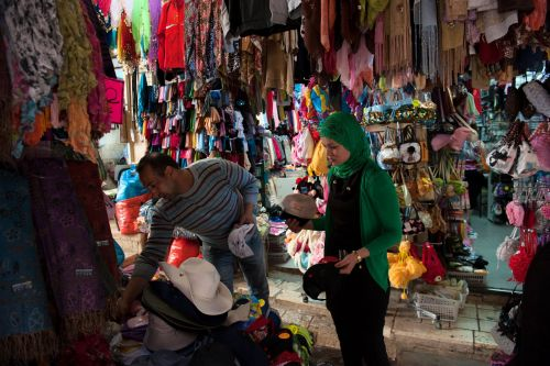 Markets-Products - Old City market, Jerusalem, Israel:  Woman picking hats