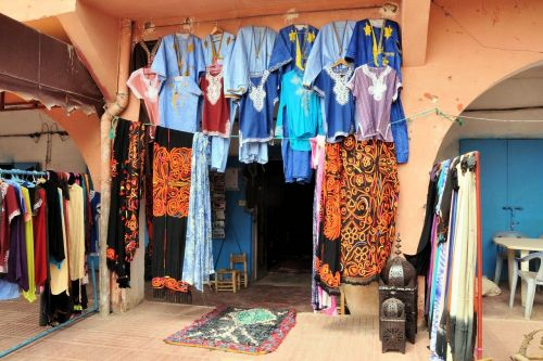 Markets-Products - Marrakesh market, Morocco: Kaftans, jabadors and jilabas for sale.