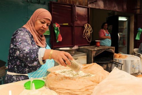 Markets-Vendors - Acre market, Israel: Preparing lafah (Arabic: لفة, Hebrew: לאפה‎‎) a Middle Eastern flatbread
