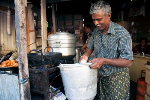 Markets-Vendors - Kochi (Cochin) market,  India: Deep-frying samosa