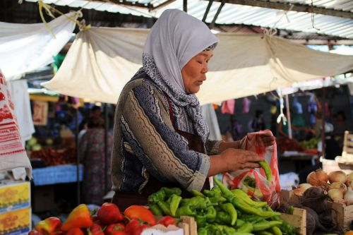 Markets-Vendors - Bishkek market, Kyrgyzstan: Woman filling bag with peppers