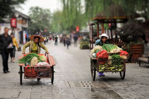 Markets-Vendors - On the way to Dali market, China: Two women in vegetable cart race