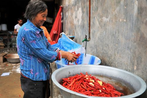 Markets-Vendors - Lijiang market, China: Washing chilly red peppers