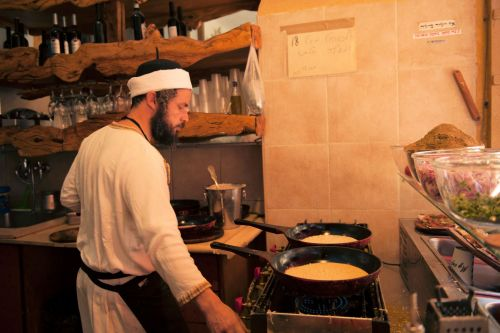 Markets-Vendors - Safed (Hebrew צפת Zfat), Israel: Yemenite  coffee shop preparing Malawach - Yemeni Pancakes