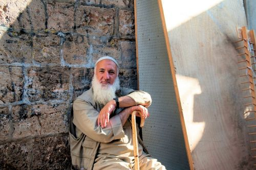 Old-Age – Israel, Old-City, Jerusalem: An old bearded man, resting on his staff