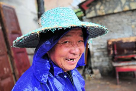Faces of China: Guiyang, Guizhou Province - Smiling man with straw hat