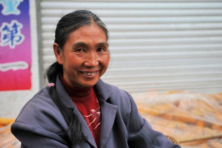 Faces of China: Shizong County, Qujing Prefecture, Yunnan Province - A Happy Woman at the market