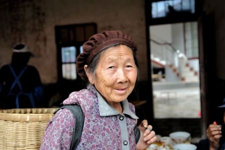 Faces of China: Old Chinese Lady with a warm smile, Shizong County, Yunnan Province