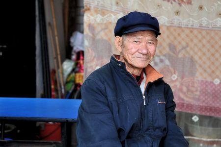 Faces of China: A man sitting in Kunming, Yunnan Province