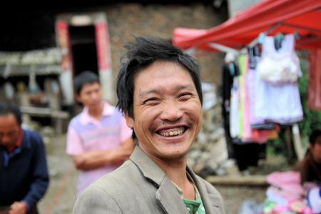 Faces of China: The Happiest Man in Guiyang Market, Guizhou Province