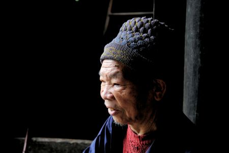 Faces of China: Sitting on a wooden bench / With a woolen hat, / Did not want to look at me / Did not want to chat. Guiyang, Guizhou Province
