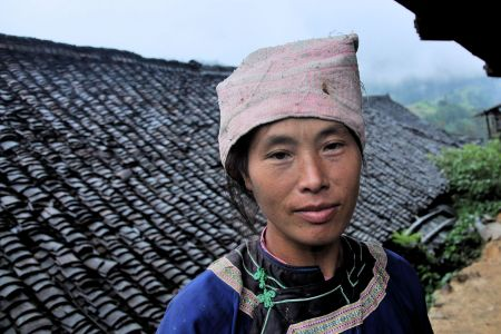 Faces of China: A Chinese village girl tired after working all day