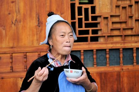Faces of China: Miao Woman Eating Noodles, Kaili, Guizhou province