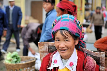 Faces of China: A woman at the market with an empty bag, Dali, Yunnan Province