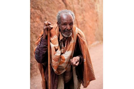 Faces of Ethiopia: Beggar - hardly walking even with a stick