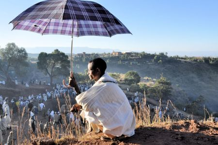 Faces of Ethiopia: Lalibela; On the hill with an umbrella