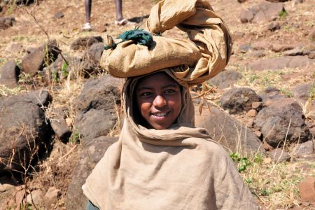 Faces of Ethiopia: A girl carrying a bag on her head