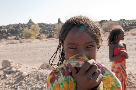 Faces of Ethiopia: A beautiful, smiling, shy, green eyed Ethiopian girl