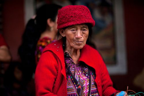 Faces of Guatemala: Woman with red hat