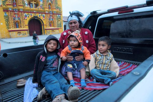 Faces of Guatemala: Mother and children in the back of a pickup truck