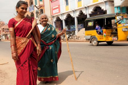 Faces of India: A blind woman being lead