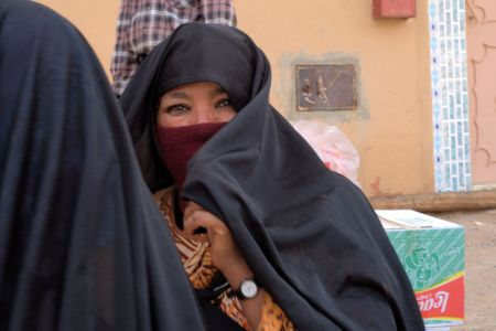Faces of Morocco: Young woman covered with black khimar