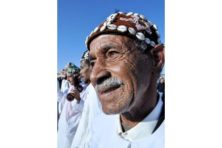 Faces of Morocco: Dancing in the market; smile, mustache and colorful taqiyah