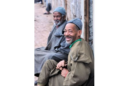Faces of Morocco: Two elderly men smiling, in anticipation of  baksheesh