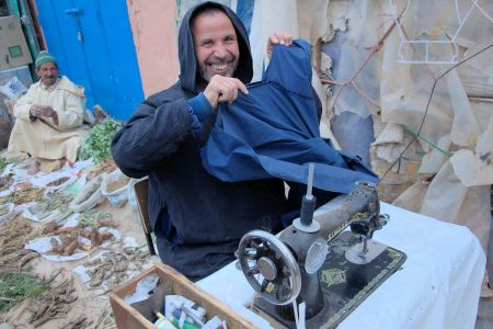 Faces of Morocco: A happy tailor-Sewing in the Marrakesh market