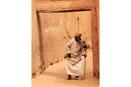 Faces of Morocco: An old man hobbling through the gateway